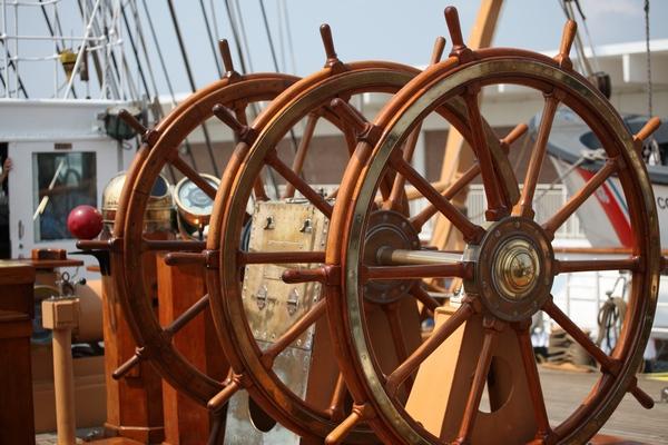 Photo of three vintage wooden vessel steering wheel